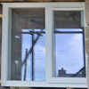 Close up of a window frame as it's being fitted
